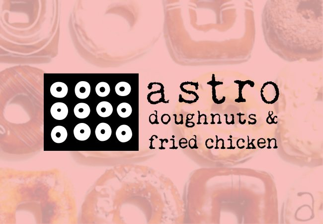 The cover photo for Astro doughnuts & fried chicken features their logo on a heavily pink tinted background