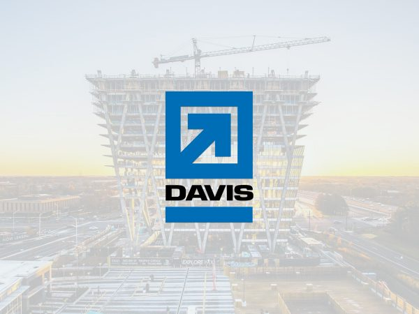 The cover photo for Davis Construction features their logo on a heavily white tinted background